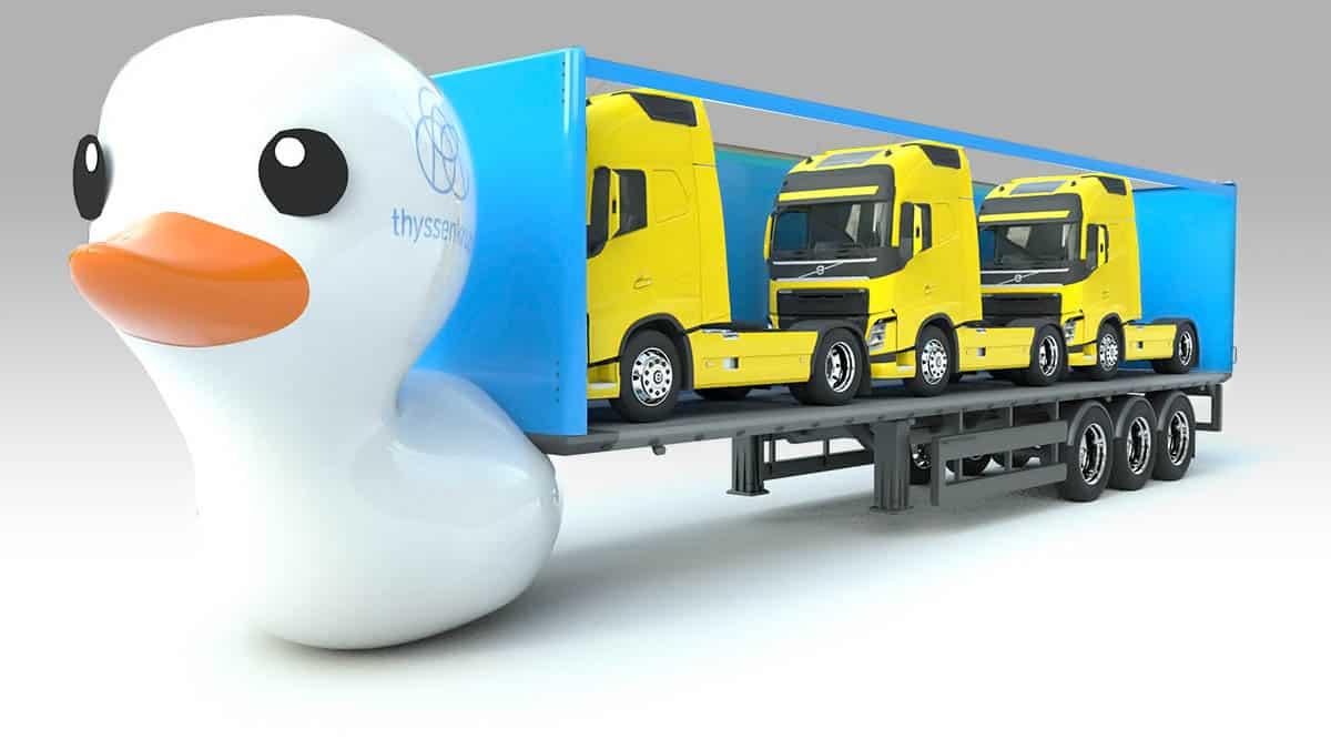 Man sieht ein 3D animiertes Bild von einer Ente die einen Anhänger voll mit LKWs zieht.